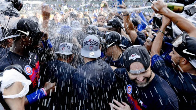 Sep 26, 2015; Chicago, IL, USA; Chicago Cubs players celebrate clinching their 2015 post season appearance after their game against the Pittsburgh Pirates at Wrigley Field. Mandatory Credit: Matt Marton-USA TODAY Sports