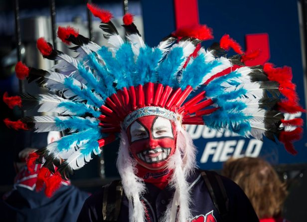 Cleveland Indians fan Austin Howell waits for the gates to open before Game 1 of the baseball American League Championship Series between the Indians and the Toronto Blue Jays on Friday, Oct. 13, 2016, in Cleveland. (Nathan Denette/The Canadian Press via AP) ORG XMIT: NSD101